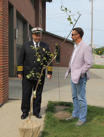 ADAM RANDALL   THE GOSHEN NEWS<br /> Goshen Fire Department Asst. Chief Mike Happer, and Mayor Jeremy Stutsman, discuss the 9/11 sapling at the Goshen Central Fire Station on Third Street Monday afternoon.