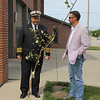 ADAM RANDALL | THE GOSHEN NEWS<br /> Goshen Fire Department Asst. Chief Mike Happer, and Mayor Jeremy Stutsman, discuss the 9/11 sapling at the Goshen Central Fire Station on Third Street Monday afternoon.