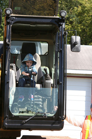 SHEILA SELMAN | THE GOSHEN NEWS<br /> Mason Owens, 3, Elkhart, enjoys being in the driver's seat of a piece of excavation equipment during Touch-A-Truck at Faith United Methodist Church near Goshen Saturday.
