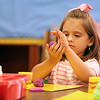 JULIE CROTHERS BEER | THE GOSHEN NEWS<br /> Kindergartner Ava Morningstar works with Play-doh on her first day of school Wednesday at Nappanee Elementary School.