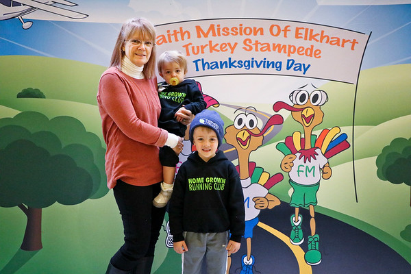 LEANDRA BEABOUT | THE GOSHEN NEWS<br /> Melinda Kallimani of Elkhart stands with her grandchildren as they wait for their mom to finish the Turkey Stampede.