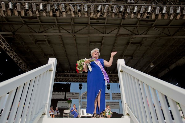 JAY YOUNG | THE GOSHEN NEWS<br /> Newly crowned senior queen Tena Jakubowicz waits for the crowd after being crowned Friday afternoon at the Elkhart County 4-H Fair.