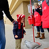 BEN MIKESELL | THE GOSHEN NEWS<br /> Abel Miller, 3, of Goshen, walks into Walmart with his grandpa Jeff Peters of Angola after donating to the Salvation Army outside of Walmart in Goshen.