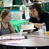 Roger Schneider | The Goshen News<br /> Hannah Bower, 11, of LaGrange, listens to advice about her 4-H project from Jenette Marker of Noble County, who was judging the cake decorating contest at the LaGrange County 4-H Fair Saturday.
