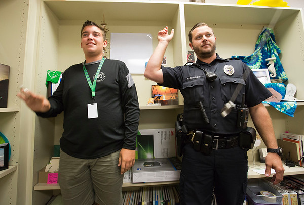 JAY YOUNG | THE GOSHEN NEWS<br /> Concord police officer Nic Minder plays a quick game of ring toss with Concord High School student body president Will Boyer during fifth hour Thursday afternoon at Concord High School. The Concord School District recently incorporated a new police department.