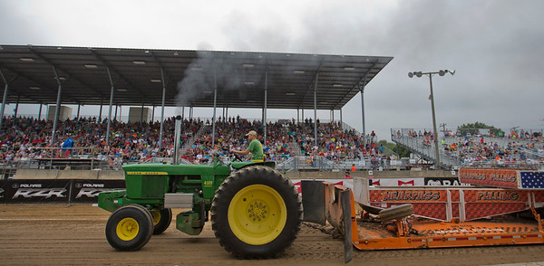 JAY YOUNG | THE GOSHEN NEWS<br /> Ben Sheets competes in the tractor pull competition Thursday morning at the Elkhart County 4-H Fair.