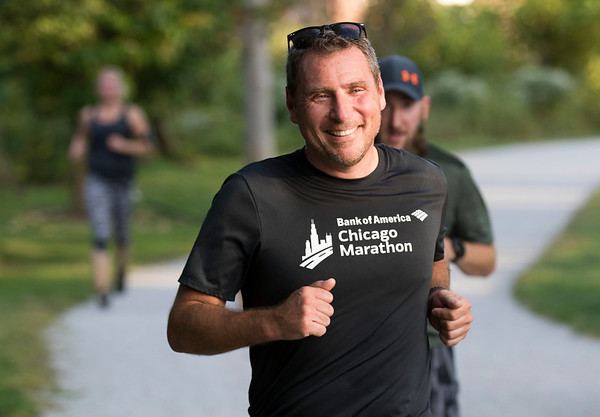 JAY YOUNG | THE GOSHEN NEWS<br /> Goshen resident Steve Freeto is all smiles as he nears the end of The Goshen Brewery Company's weekly Goshen Millrace Dam Beer Run Thursday evening. Every Thursday at 6 p.m. runners meet outside the brewery and run to the dam and back, about four miles. Afterwards, the runners meet up and enjoy drinks at the brewery. The runs are free and open to the public.