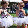 CHRISTINA CLARK | THE GOSHEN NEWS Abigail Hunnings, 4, and Kayleigh Dewulf, 4, of Robin's School of Dance prepare to take the stage.