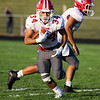 CHAD WEAVER | THE GOSHEN NEWS<br /> Goshen running back Liam Morales looks for running room after taking a handoff during the second quarter of Friday night's game at Fairfield.