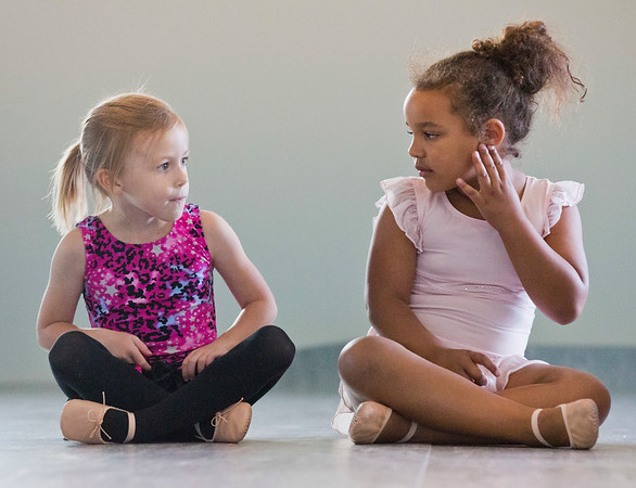 JAY YOUNG | THE GOSHEN NEWS<br /> Harper Kelly, left, and Khloe Beachy take a short break from dancing during a Kinderdance class Wednesday evening at Epic Dance Studios.