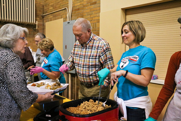 "LEANDRA BEABOUT | THE GOSHEN NEWS<br /> Members of First United Methodist Church's ""New Beginnings"" Sunday School class, along with their friends and family, served Thanksgiving dinner to the community from 11 a.m. to 1 p.m. on Thursday."