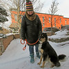 AIMEE AMBROSE | THE GOSHEN NEWS <br /> Piper, a 2-year-old dog, takes a quick break from walking with Tonya Bontrager, in downtown Goshen.