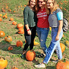 Roger Schneider | The Goshen News<br /> Janet Holzman, center, of Chicago, poses for a photo with her daughters, Lindsay, 16, left, and Marley, 20. They were  picking out pumpkins during the fall harvest festival at Kercher's Sunrise Orchard and Farm Market in Goshen.