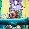 JAY YOUNG | THE GOSHEN NEWS<br /> Two-year-old Averie Perry, of Millersburg, giggles as she is lifted into the air on the Frog Hopper ride at the Elkhart County 4-H Fair Monday afternoon.