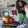 SHEILA SELMAN | THE GOSHEN NEWS<br /> Flight nurse Stacey Laubach, left, welcomes Levi Sears and mom Brittany on board Memorial Medflight helicopter Saturday during Touch-A-Truck at Faith United Methodist Church, north of Goshen.