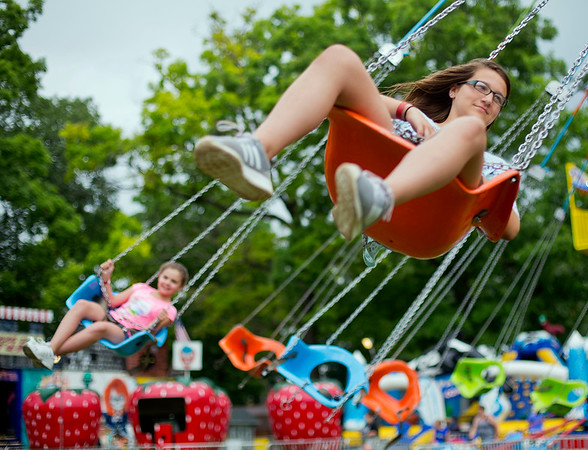 JAY YOUNG | THE GOSHEN NEWS<br /> Thirteen-year-old Allison Martin, of Kendallville, gets some air under her feet as she takes a ride on the spinning swings at the Noble County Fair Tuesday afternoon in Kendallville. The fair continues through Saturday.