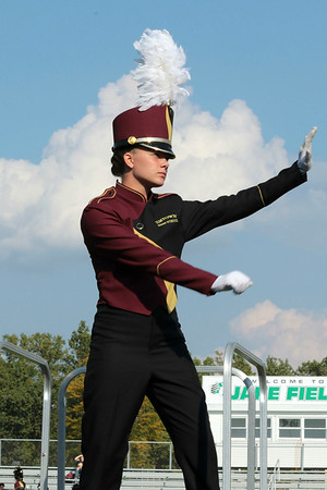 Gweniviere Seegers drum major, salutes the judges to begin Jimtown's performance at the Concord invitational on Saturday.