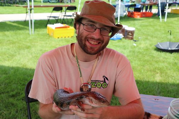 Matt Russell,  a Potawatomi Zoo staff member holds a reptile.