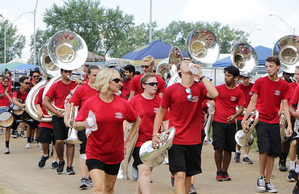 STACEY DIAMOND | THE GOSHEN NEWS<br /> Members of the Crimson Marching Band cool off after their parade performance.