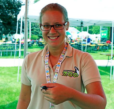Katy Bail, a Potawatomi Zoo staff member holds a beetle.