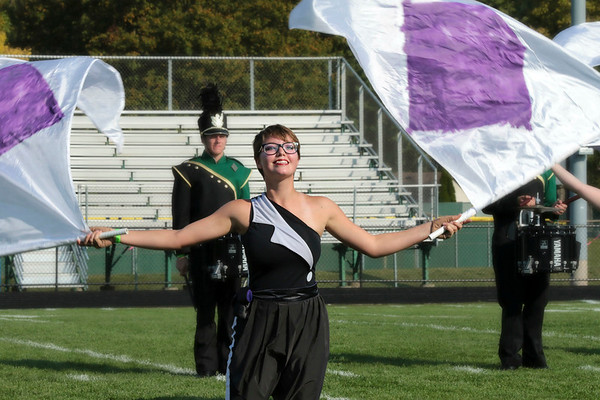 Kala Bailey puts on a show for the crowd  with her flags as part of the Wawasee Marching<br /> Warrior Pride.