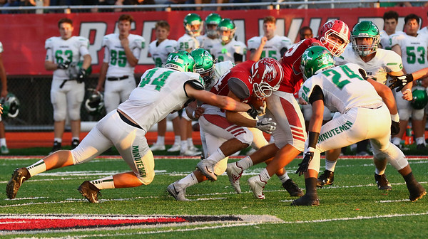 JAY YOUNG | THE GOSHEN NEWS<br /> Goshen High School senior running back Liam Morales fights for extra yardage as he is pulled down from behind by Concord High School senior defensive lineman Brady Reed (44) during their game Friday night at GHS.