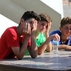 ADAM RANDALL | THE GOSHEN NEWS<br /> From left: Cohen Custer, 12, Brooks Custer, 10, and Austin Custer, 13, all of Syracuse, take a break during the Flotilla Road Race Tuesday.