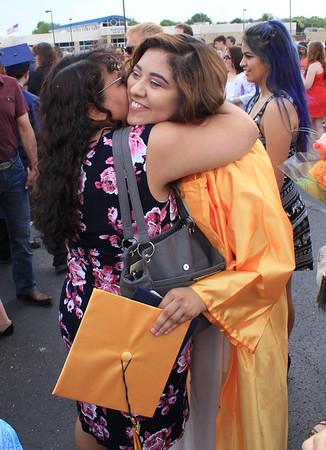 Roger Schneider   The Goshen News<br /> Esmeralda Marin receives a big hug from her mother Julia after graduating from Fairfield Jr.-Sr. High School Sunday.