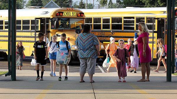 JULIE CROTHERS BEER | THE GOSHEN NEWS<br /> Students arrive for the first day of school Wednesday at Nappanee Elementary School.