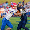 CHAD WEAVER | THE GOSHEN NEWS<br /> Fairfield running back Cooper Abramson tries to break away from West Noble defensive back Steven Loy after making a catch during the second quarter of Friday night's game at Fairfield.
