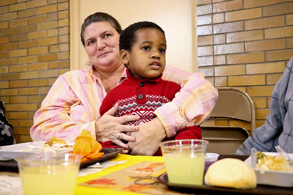 LEANDRA BEABOUT | THE GOSHEN NEWS<br /> Rutie LeBau invited three-year-old Noh'lan Suggs to sit with her while she are Thanksgiving dinner at First United Methodist Church in Goshen.