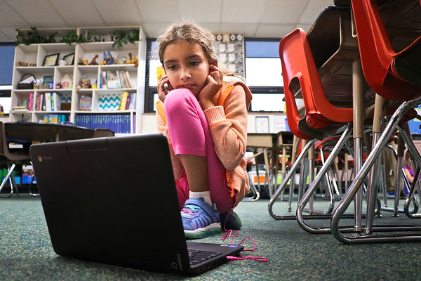 LEANDRA BEABOUT | THE GOSHEN NEWS<br /> Second-grader Sophia KhattriChettri listens to an audiobook on one of Middlebury Elementary School's new Chromebooks.