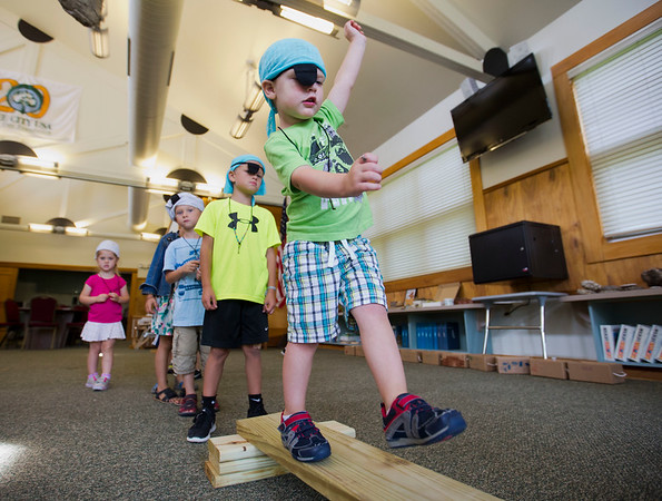 JAY YOUNG   THE GOSHEN NEWS<br /> Three-year-old Ryan Burt, of Goshen, learns what life as a pirate is like as he walks the plank Tuesday morning at the Rieth Interpretative Center during Pirate Camp hosted by the Goshen Parks and Recreation Department. Children attending the camp read stories about pirates, created a treasure map and practiced walking the plank, all while dressing like pirates.