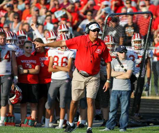 CHAD WEAVER | THE GOSHEN NEWS<br /> Goshen head coach Kyle Park gestures on the sideline during the first quarter of Friday night's game at Fairfield.