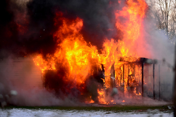 BEN MIKESELL | THE GOSHEN NEWS<br /> A garage fire quickly spread through a house Tuesday morning on the 16000 block of C.R. 40 in Goshen. Residents of the home safely evacuated, thanks to passersby who notified authorities and woke up the residents.