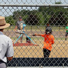 JULIE CROTHERS BEER | THE GOSHEN NEWS A spectator watches as children participate in the Home Run Derby event Tuesday in Nappanee. The event was part of the city's annual Independence Day celebration at Stauffer Park.