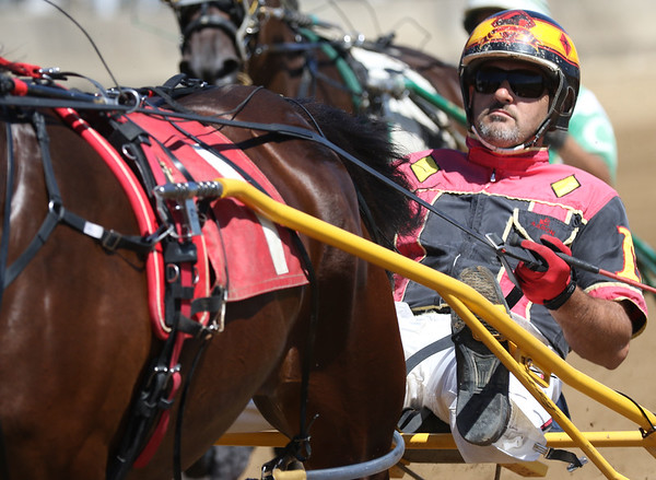 JAY YOUNG | THE GOSHEN NEWS<br /> Aaron Miller guides his horse Awesum Ace during the fourth race Tuesday morning on the final day of harness racing at the Elkhart County 4-H Fair.