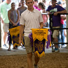 JAY YOUNG | THE GOSHEN NEWS<br /> Noah Nisen, of Elkhart, is recognized during the parade of champions Thursday evening at the Elkhart County 4-H Fair. Nisen was named the grand champion for Brown Swiss Dairy Cows.