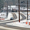 Roger Schneider | The Goshen News<br /> A lone vehicle makes its way westbound over the new Kercher Road Bridge Monday afternoon. The bridge and C.R. 38 from Ind. 15 to C.R. 17 was reopened over the weekend after many months of being closed or restricted to traffic. The rebuilt road and bridge is wider than the previous county road and has turning lanes at intersections. Not all lane striping has been installed and county officials cautioned Friday that drivers should slow down and be careful.