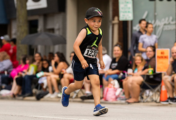 JAY YOUNG   THE GOSHEN NEWS<br /> (1230), one of the youngest competitors, concentrates as he makes his way down Main Street through downtown Goshen while running in the annual Elkhart County 4-H Fair road race Sunday afternoon.