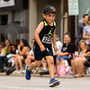 JAY YOUNG | THE GOSHEN NEWS<br /> (1230), one of the youngest competitors, concentrates as he makes his way down Main Street through downtown Goshen while running in the annual Elkhart County 4-H Fair road race Sunday afternoon.