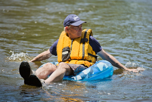JAY YOUNG | THE GOSHEN NEWS<br /> Elkhart Mayor Tim Neese paddles in the water as he floats down the Elkhart River during the Rhapsody in Green Music Festival at Island and Bicentennial Parks in Elkhart.