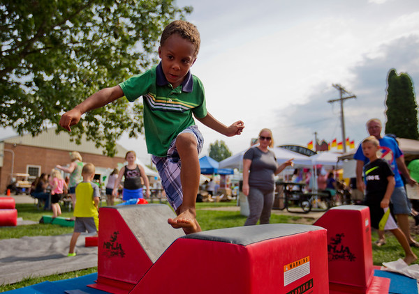 JAY YOUNG | THE GOSHEN NEWS<br /> Six-year-old Gabriel Goeglein, of New Paris, shows off his ninja skills as he completes an obstacle course   during Kids' Day at the Elkhart County 4-H Fair Wednesday morning.