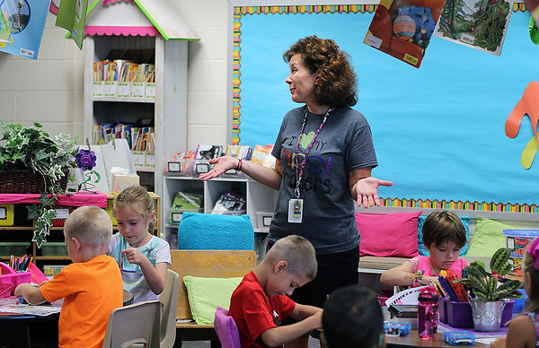 JULIE CROTHERS BEER | THE GOSHEN NEWS<br /> First-grade teacher Tammy Miller talks with students about their lunch schedules on the first day of school Wednesday at Nappanee Elementary School.