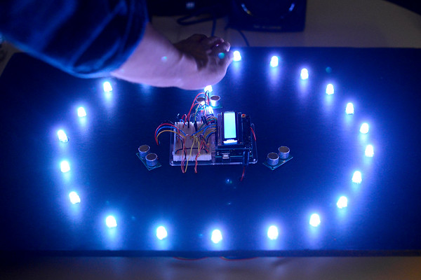 BEN MIKESELL | THE GOSHEN NEWS<br /> Spencer Aeschliman and Logan Swartzendruber, juniors at Goshen College, present their interactive light and sound display for their year-end electronics project Monday at Goshen College's 2017 Electronics & Robotics Show. The display works by moving hands across sensors to control musical notes and LED lights.