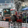JAY YOUNG | THE GOSHEN NEWS<br /> Black smoke rises from a tractor as a competitor starts a run in the tractor pull competition Thursday morning at the Elkhart County 4-H Fair.