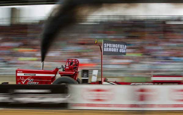 JAY YOUNG | THE GOSHEN NEWS<br /> Ryan Anderson speeds past the grandstand in his tractor named Checkin' Out during the super farm class tractor pull competition Thursday morning at the Elkhart County 4-H Fair.