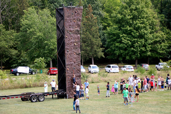 SHERRY VAN ARSDALL | THE GOSHEN NEWS<br /> Visitors take their turn at the rock wall during the 50th celebration of Elkhart County Parks at Ox Bow County Park in Dunlap Sunday afternoon.