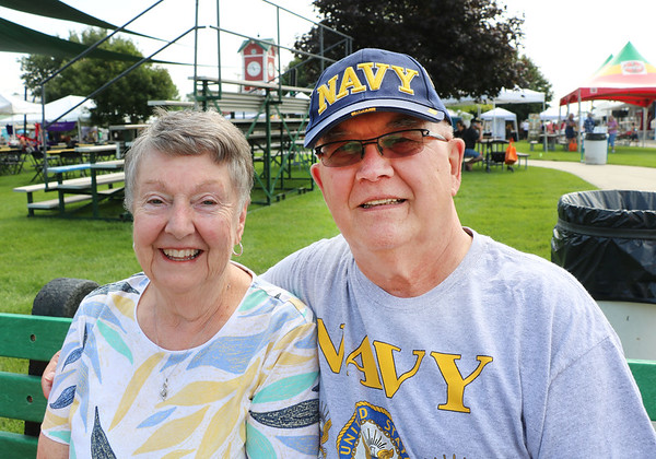 "LEANDRA BEABOUT | THE GOSHEN NEWS<br /> Kathleen Peterson with her husband Thomas Peterson, a U.S. Navy veteran. Throughout his four years of military service, Thomas was stationed in New London, Connecticut; Norfolk, Virginia; San Diego, California; and Windsor, Connecticut. The Petersons enjoyed walking around the Elkhart County 4-H fairgrounds on Friday morning, ""before it gets crowded,"" they said."