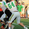 Stacey Diamond | The Goshen News<br /> The Raiders Micah Yoder, 64, tackles Warsaw's Craig Miner.